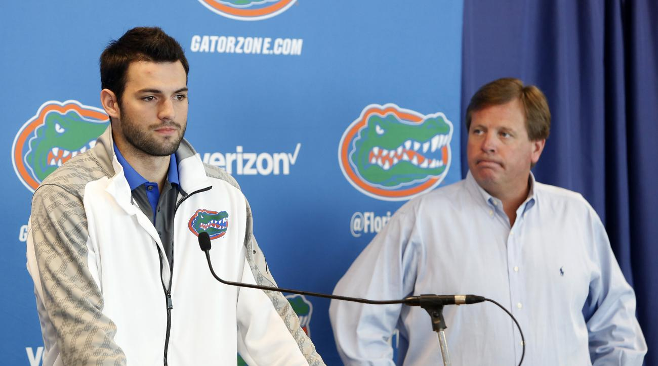 Florida Gators quarterback Will Grier, left, speaks to members of the media as head coach Jim McElwain listens Monday, Oct. 12, 2015, in Gainesville, Fla. Grier has been suspended indefinitely for violating the NCAA's policy on banned performance-enhancin