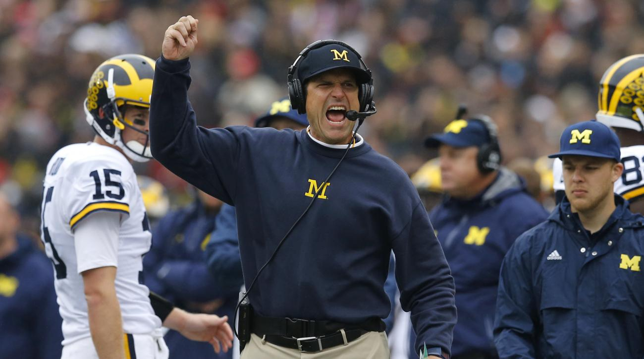 FILE - In this oct. 3, 2015, file photo, Michigan head coach Jim Harbaugh calls for a flag in the first half of an NCAA college football game against Maryland in College Park, Md. Jim Harbaugh has poured all of his unique energy and relentless passion int