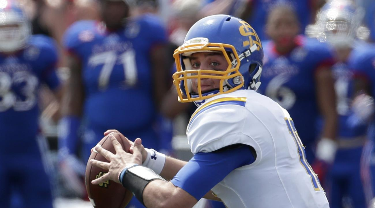 South Dakota State quarterback Zach Lujan (16) passes the ball during the second half of an NCAA football game against Kansas Saturday, Sept. 5, 2015, in Lawrence, Kan. South Dakota State won 41-38. (AP Photo/Charlie Riedel)