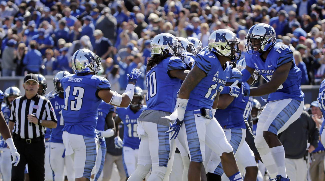 Memphis defensive players celebrate after forcing a turnover on downs against Mississippi in the first half of an NCAA college football game Saturday, Oct. 17, 2015, in Memphis, Tenn. (AP Photo/Mark Humphrey)