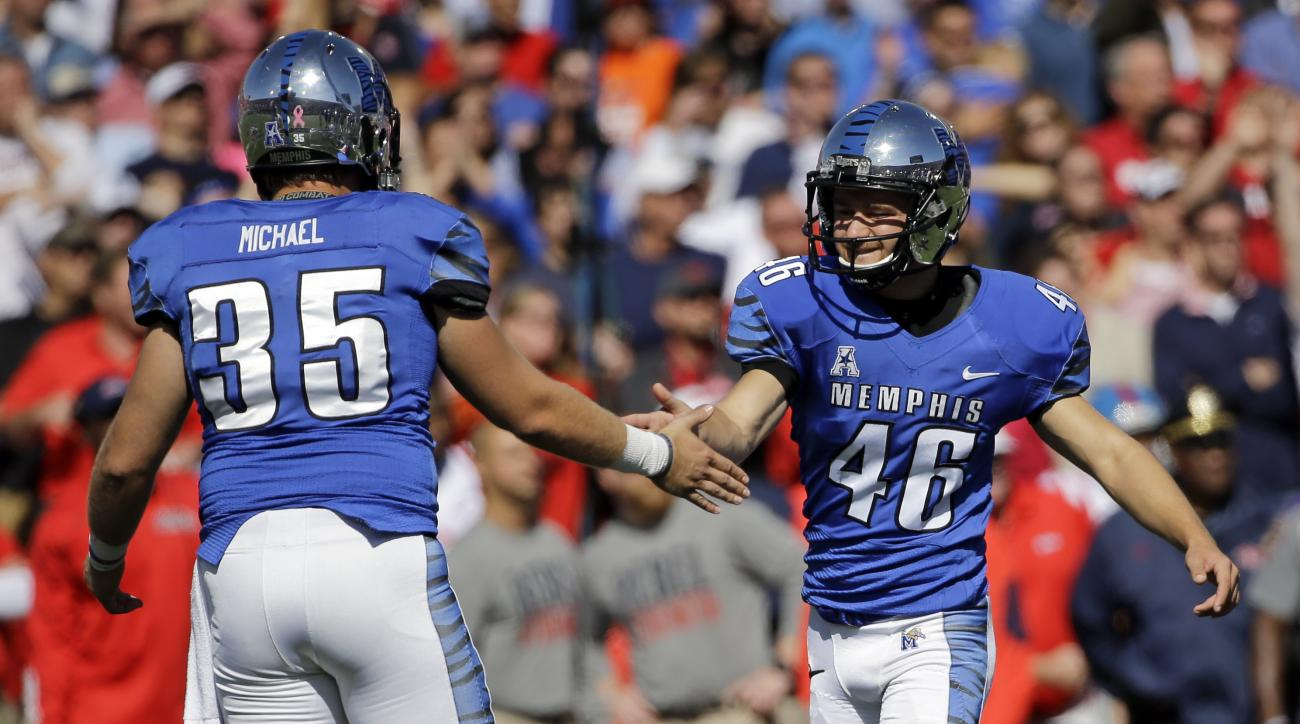 Memphis place kicker Jake Elliott (46) is congratulated by holder Evan Michael (35) after Elliott kicked a 27-yard field goal against Mississippi in the second half of an NCAA college football game Saturday, Oct. 17, 2015, in Memphis, Tenn. Memphis upset