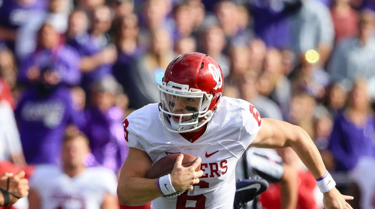 Oklahoma quarterback Baker Mayfield (6) carries the ball during the first half of an NCAA college football game against Kansas State in Manhattan, Kan., Saturday, Oct. 17, 2015. (AP Photo/Nati Harnik)