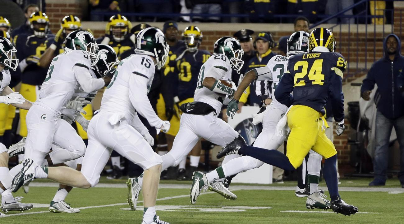 Michigan State defensive back Jalen Watts-Jackson (20) runs towards the end zone after recovering a fumbled snap on a punt in the closing seconds of the second half of an NCAA college football game, Saturday, Oct. 17, 2015, in Ann Arbor, Mich. Watts-Jacks