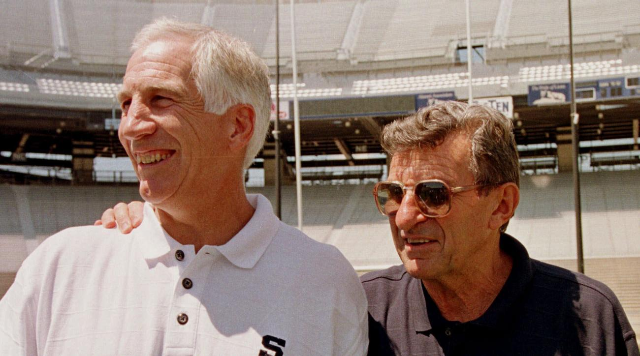 FILE - In this Aug. 6, 1999, file photo, Penn State head football coach Joe Paterno, right, poses with his defensive coordinator Jerry Sandusky during NCAA college football media Day at State College, Pa. A proposed settlement, announced Friday, Jan. 16,