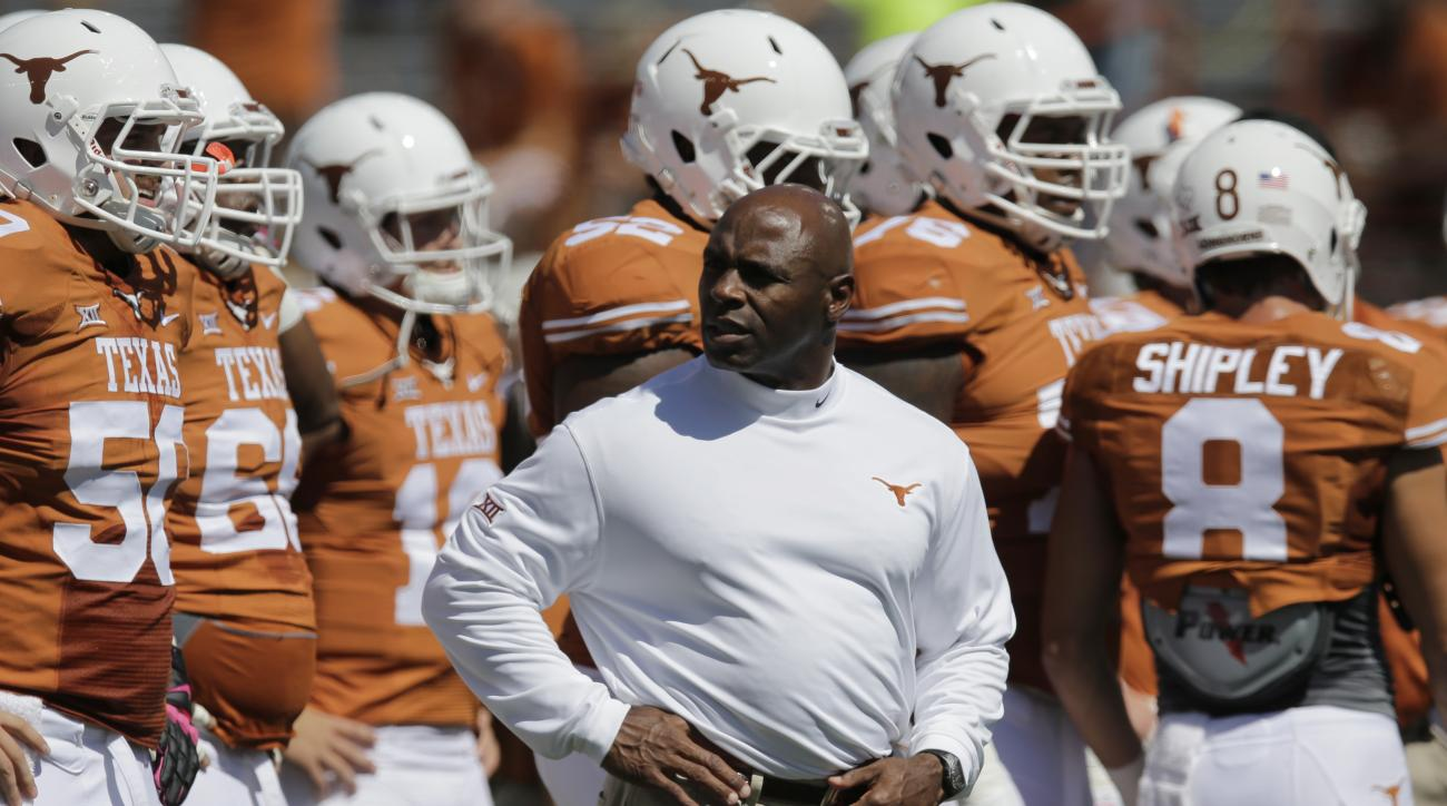 Texas Longhorns head coach Charlie Strong watches his team prior to an NCAA college football game against Baylor, Saturday, Oct. 4, 2014, in Austin, Texas. (AP Photo/Eric Gay)