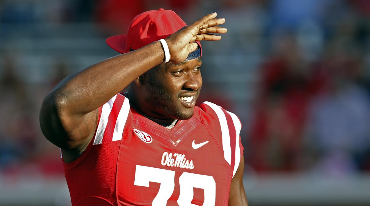 In this Sept. 26, 2015, photograph, Mississippi offensive lineman Laremy Tunsil (78) looks into the stands prior to their NCAA college football game against Vanderbilt, in Oxford, Miss. The NCAA has ruled that Tunsil can return to the field on Saturday, O