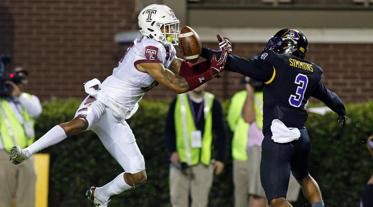 East Carolina's Travon Simmons (3) breaks up a pass intended for Temple's Frank Nutile (18) during the first half of an NCAA college football game in Greenville, N.C., Thursday, Oct. 22, 2015. (AP Photo/Karl B DeBlaker)