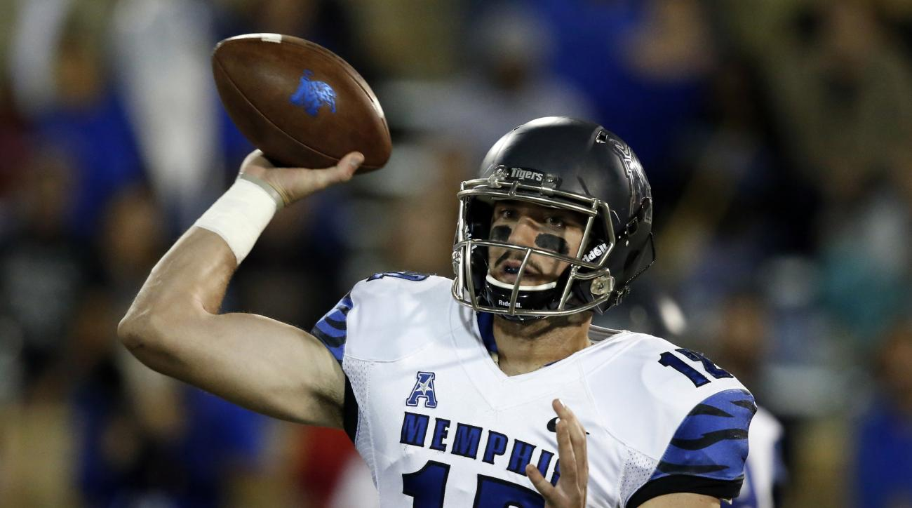 Memphis quarterback Paxton Lynch (12) passes in the first quarter of an NCAA college football game against Tulsa in Tulsa, Okla., Friday, Oct. 23, 2015. (AP Photo/Sue Ogrocki)