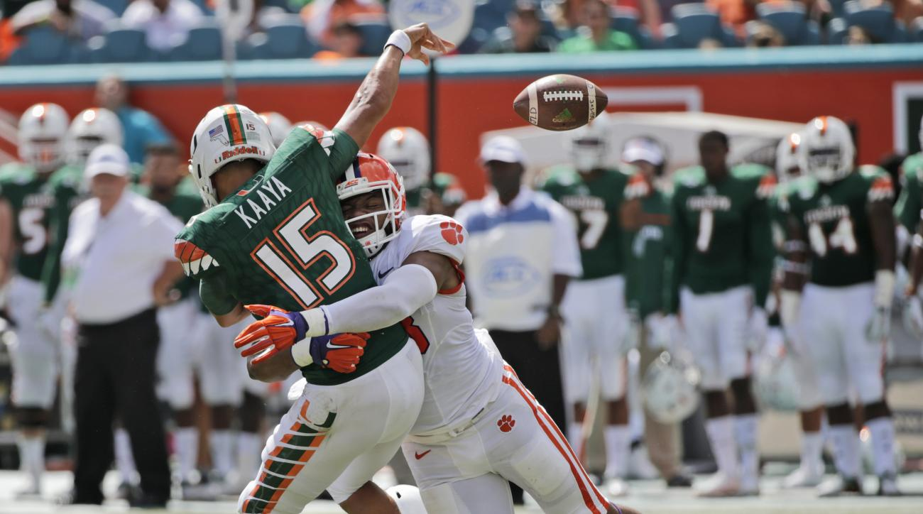Clemson defensive end Kevin Dodd tackles Miami quarterback Brad Kaaya (15) as he passes during the first half of an NCAA College football game, Saturday, Oct. 24, 2015 in Miami Gardens, Fla. (AP Photo/Wilfredo Lee)
