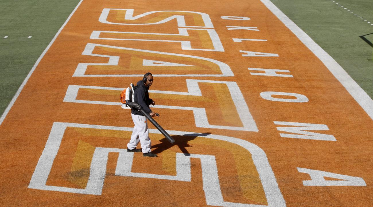 A workers uses a blower to clean the end zone at Boone Pickens Stadium in Stillwater, Okla., Monday, Oct. 31, 2011. Oklahoma State faces Kansas State in an NCAA college football game in Stillwater on Saturday. (AP Photo/Sue Ogrocki)