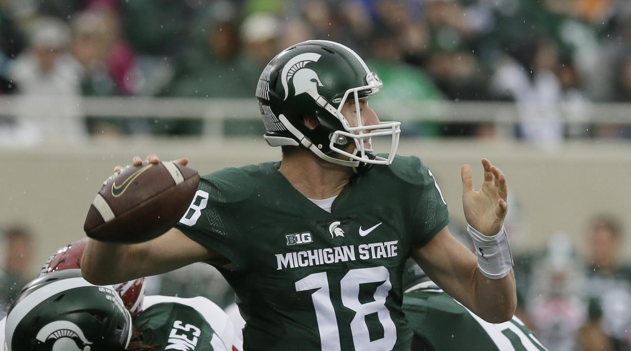 Michigan State quarterback Connor Cook (18) throws during the first half of an NCAA college football game against Indiana, Saturday, Oct. 24, 2015, in East Lansing, Mich. (AP Photo/Carlos Osorio)