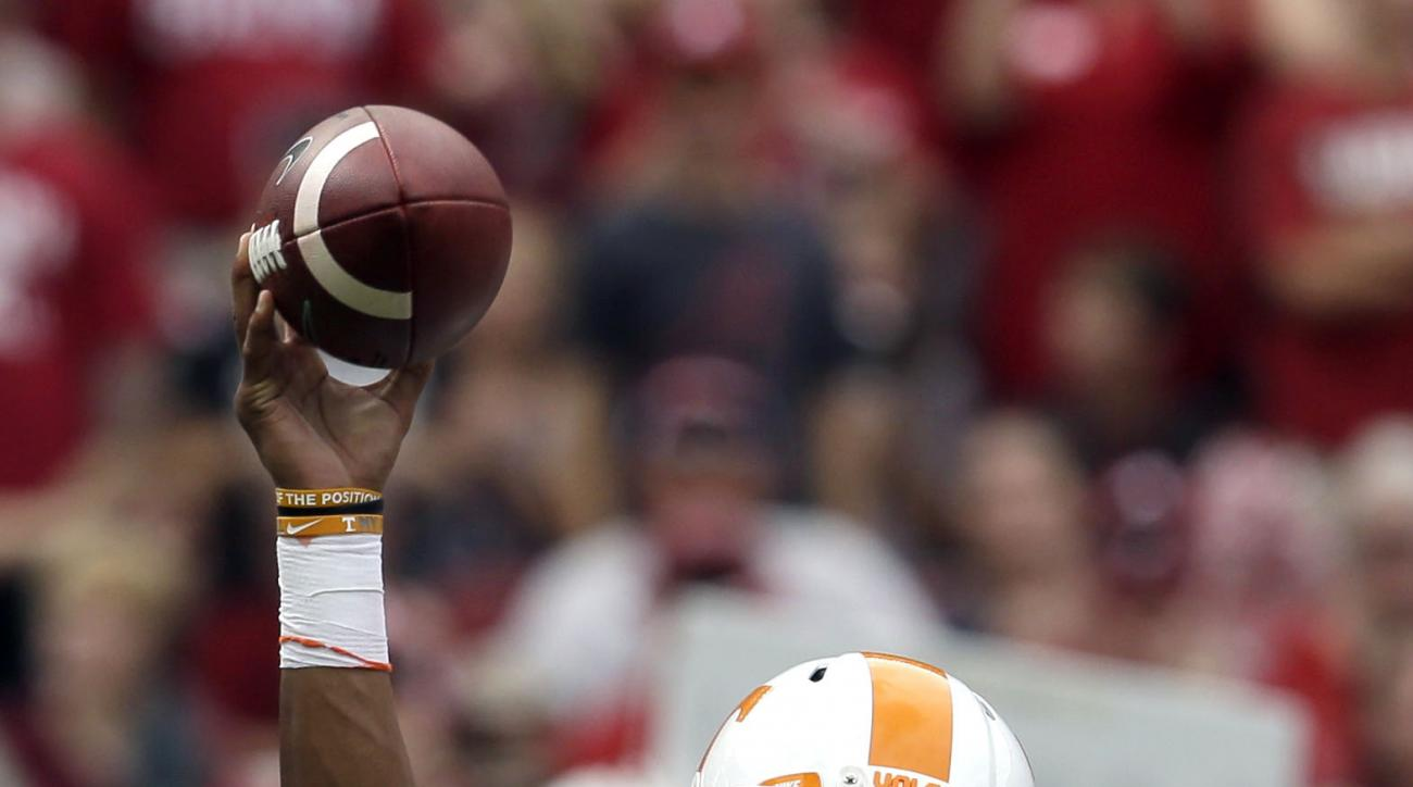 Tennessee quarterback Joshua Dobbs throws a pass during the first quarter of an NCAA college football game against Alabama, Saturday, Oct. 23, 2015, in Tuscaloosa, Ala. (AP Photo/Butch Dill)