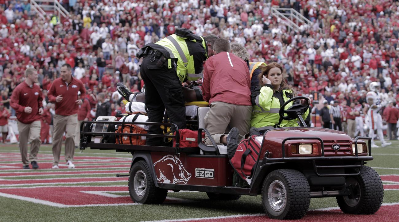 Arkansas' Rawleigh Williams III is carted off the field after he was injured during the third quarter of the NCAA college football game against Auburn, Saturday, Oct. 24, 2015, in Fayetteville, Ark. Arkansas won 54-46 in four overtimes. (AP Photo/Samantha