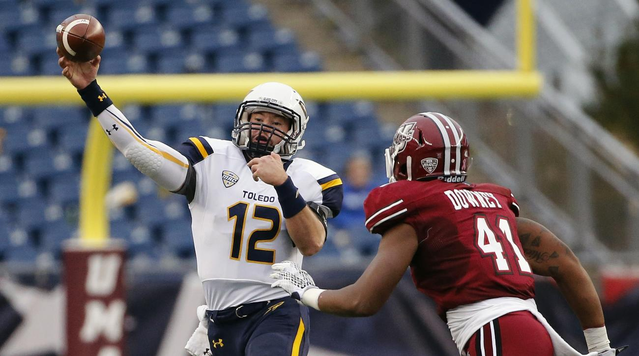 Toledo quarterback Phillip Ely (12) passes under pressure from Massachusetts linebacker Da'Sean Downey (41) during the second quarter of an NCAA college football game in Foxborough, Mass., Saturday, Oct. 24, 2015. (AP Photo/Michael Dwyer)