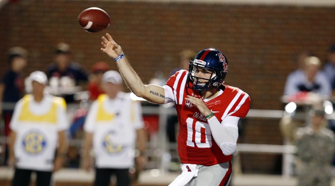 Mississippi quarterback Chad Kelly (10) passes against Texas A&M during the first half of an NCAA college football game in Oxford, Miss., Saturday, Oct. 24, 2015. (AP Photo/Rogelio V. Solis)