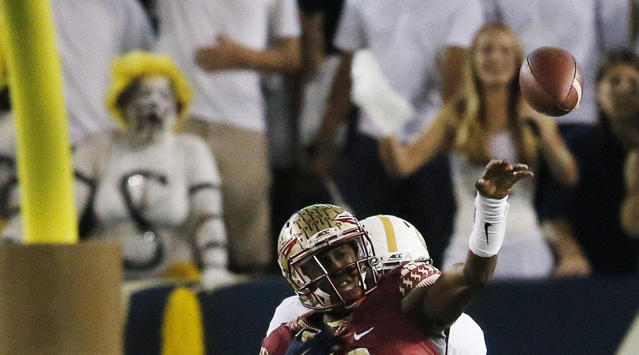 Georgia Tech defensive lineman Antonio Simmons (93) tries to tackle Florida State quarterback Everett Golson (6) during the first half of an NCAA college football game, Saturday, Oct. 24, 2015, in Atlanta. (AP Photo/Mike Stewart)