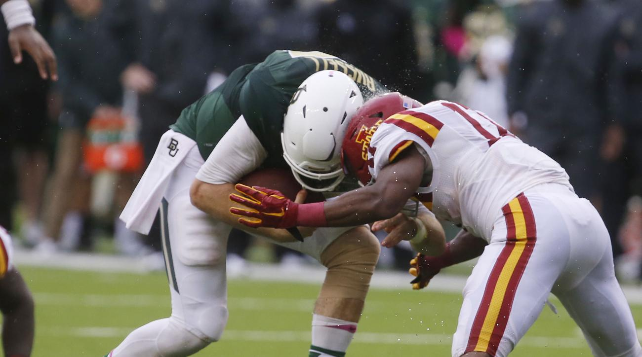 Baylor quarterback Seth Russell, left, is stopped on a running play by Iowa State defensive back Jomal Wiltz (17) in the fourth quarter of an NCAA college football game Saturday Oct. 24, 2015, in Waco, Texas. According to team officials, Russell, who left