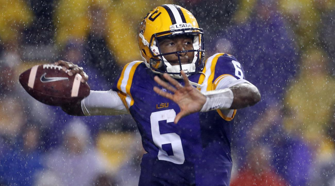 In the rain, LSU quarterback Brandon Harris (6) throws the ball during the first half an NCAA college football game against Western Kentucky in Baton Rouge, La., Saturday, Oct. 24, 2015. (AP Photo/Jonathan Bachman)