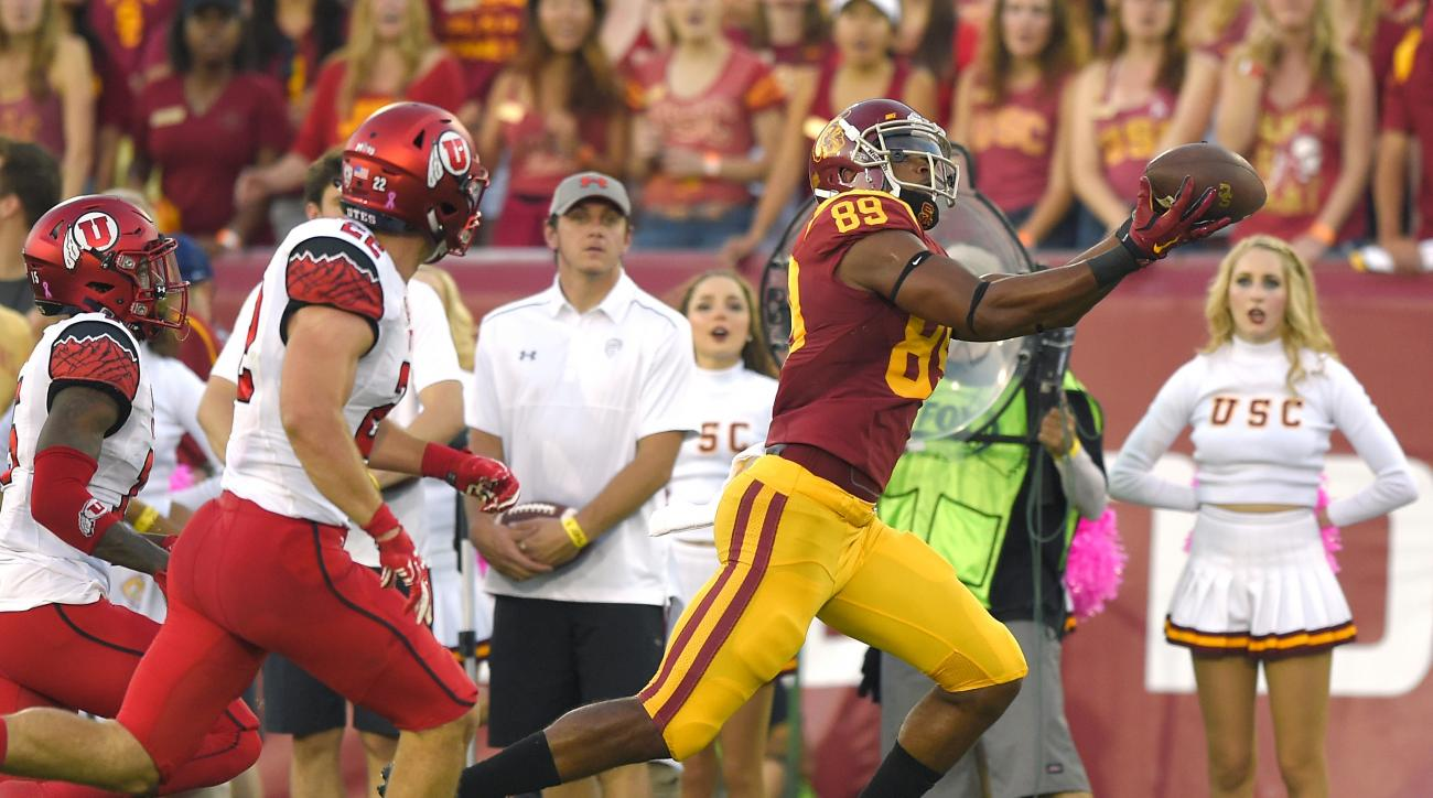 Southern California wide receiver De'Quan Hampton, right, makes a catch under pressure from Utah defensive back Dominique Hatfield, left, and defensive back Chase Hansen during the first half of an NCAA college football game, Saturday, Oct. 24, 2015, in L