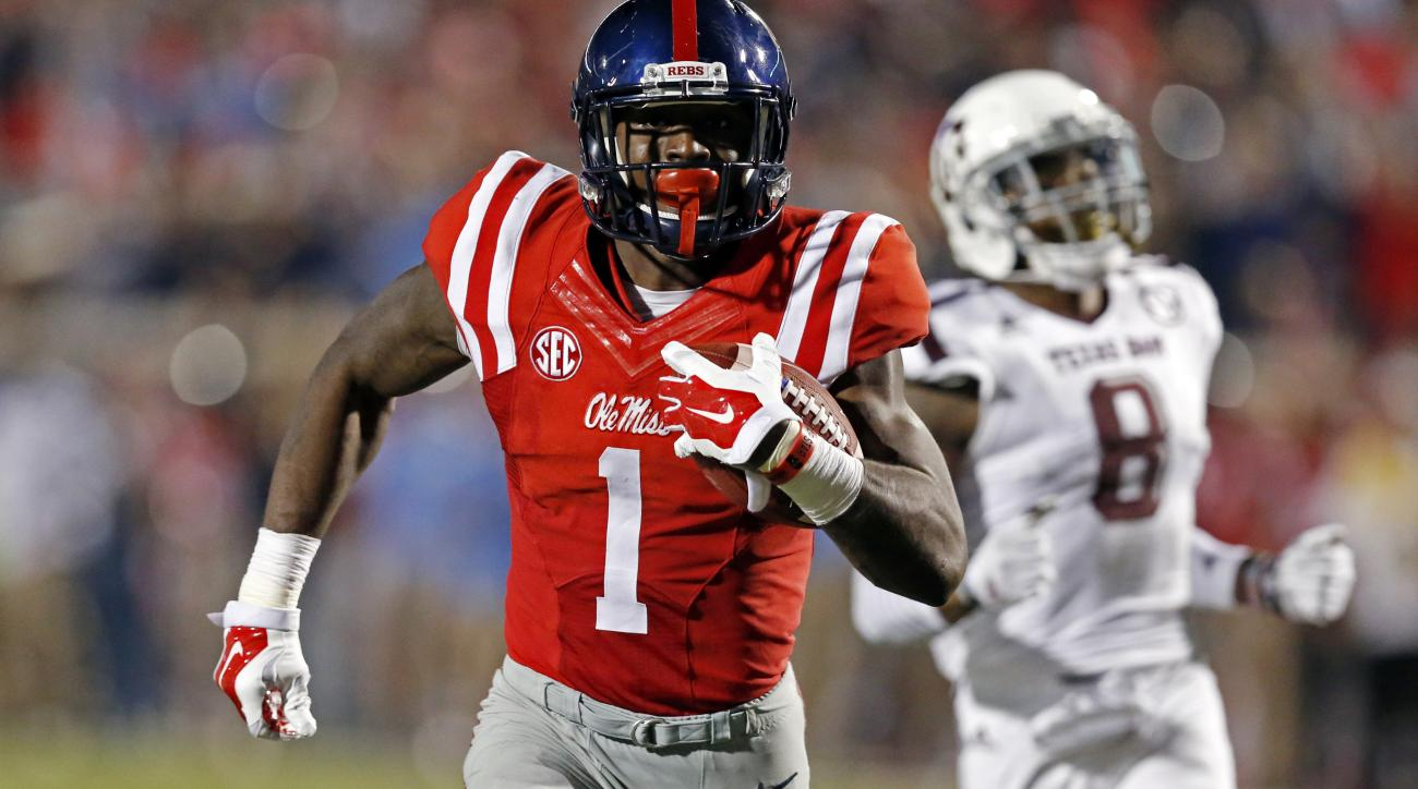 Mississippi wide receiver Laquon Treadwell (1) sprints away from Texas A&M defensive back Nick Harvey (8) for a 58 yard touchdown pass reception during the second half of their NCAA college football game in Oxford, Miss., Saturday, Oct. 24, 2015. No. 24 M
