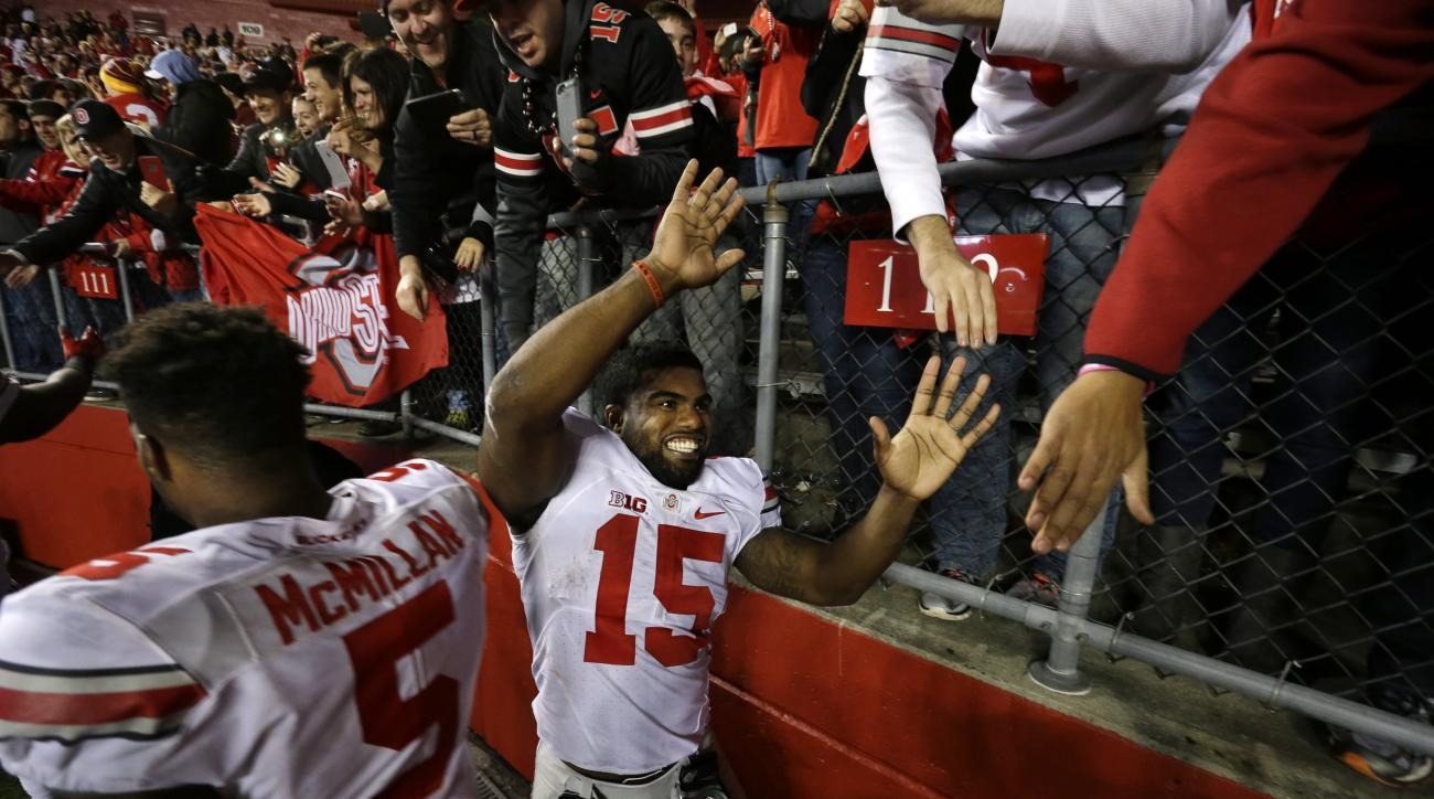 Ohio State running back Ezekiel Elliott (15) and linebacker Raekwon McMillan (5) greet fans on the field after an NCAA college football game against Rutgers, Saturday, Oct. 24, 2015, in Piscataway, N.J. Ohio State won 49-7. (AP Photo/Mel Evans)