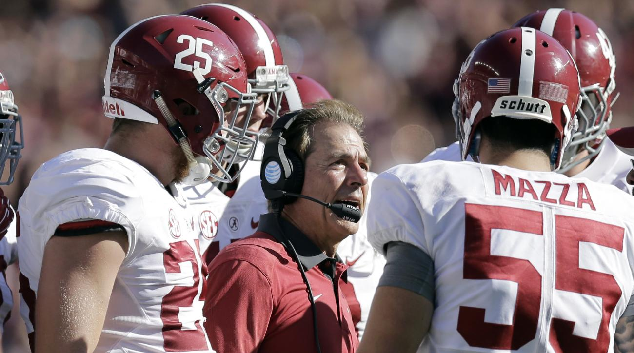 FILE - In this Oct. 17, 2015, file photo, Alabama head coach Nick Saban, center, talks to his players during the first half of an NCAA college football game against Texas A&M in College Station, Texas. The Tide need two things to happen to return to Atlan