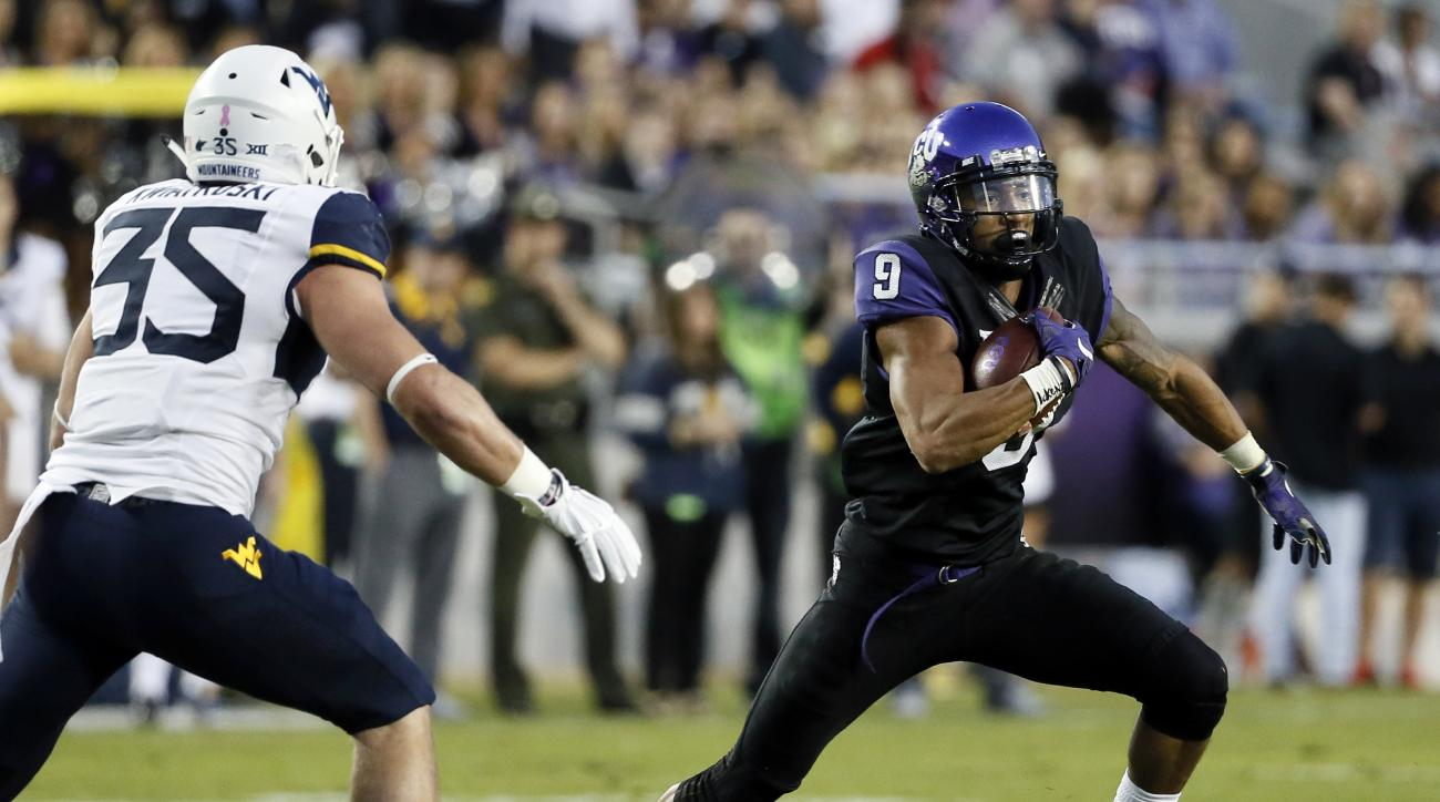 West Virginia linebacker Nick Kwiatkoski (35) chases down TCU wide receiver Josh Doctson (9) on a pass play in the first half of an NCAA college football game Thursday, Oct. 29, 2015, in Fort Worth, Texas. (AP Photo/Tony Gutierrez)