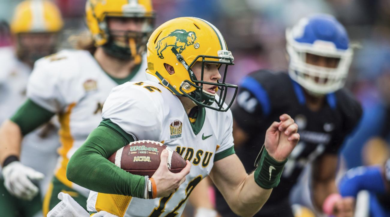 In this Oct. 24, 2015, photo provided by David Wegiel, North Dakota State University freshman quarterback Easton Stick runs with the ball during an NCAA college football game against Indiana State in Terre Haute, Ind. Stick's debut performance provided a