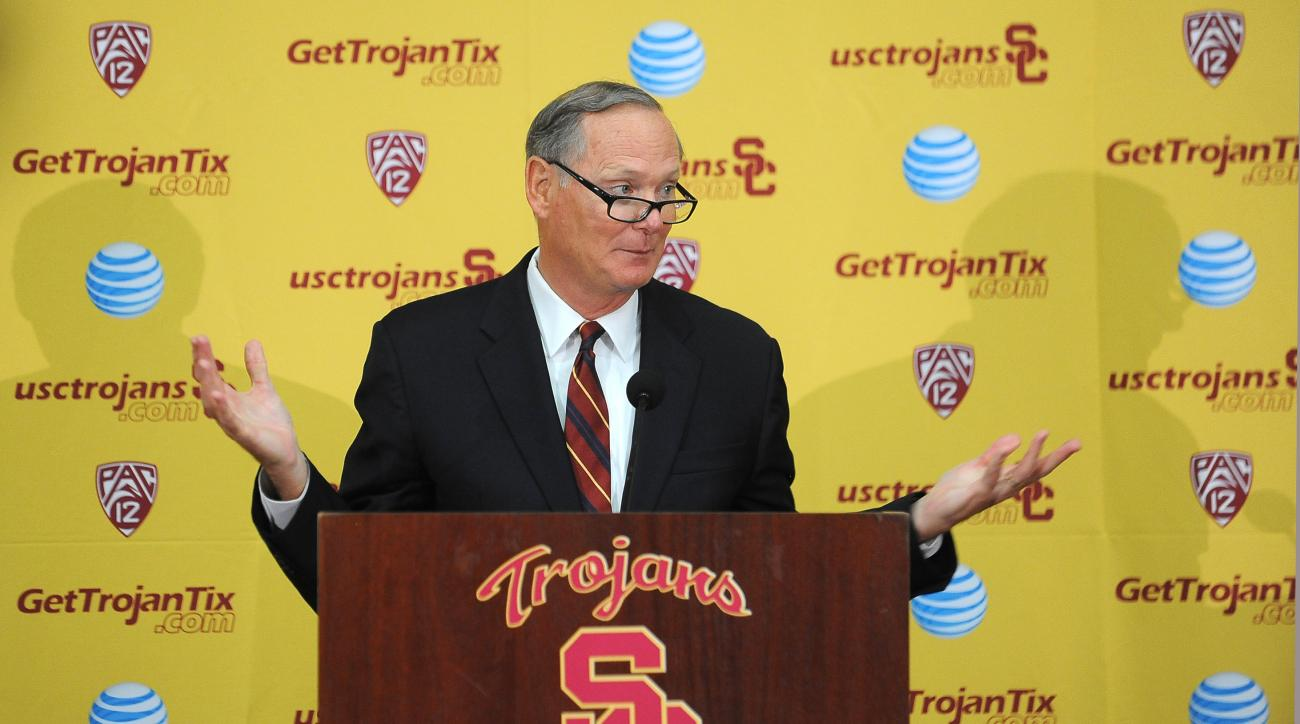 Southern California athletic director Pat Haden speaks with the media during a press conference after an NCAA college football practice in Los Angeles Tuesday, Oct. 13, 2015. He named the Trojans' offensive coordinator, Clay Helton, to take over for head