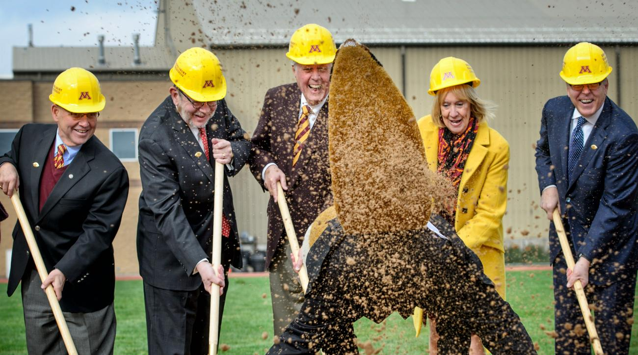 "University of Minnesota mascot ""Goldy Gopher"" throws dirt towards photographers at groundbreaking ceremonies for the ""athletes village"" Friday, Oct. 30, 2015, at the University of Minnesota in Minneapolis. From left, taking part in the ceremonies are rege"