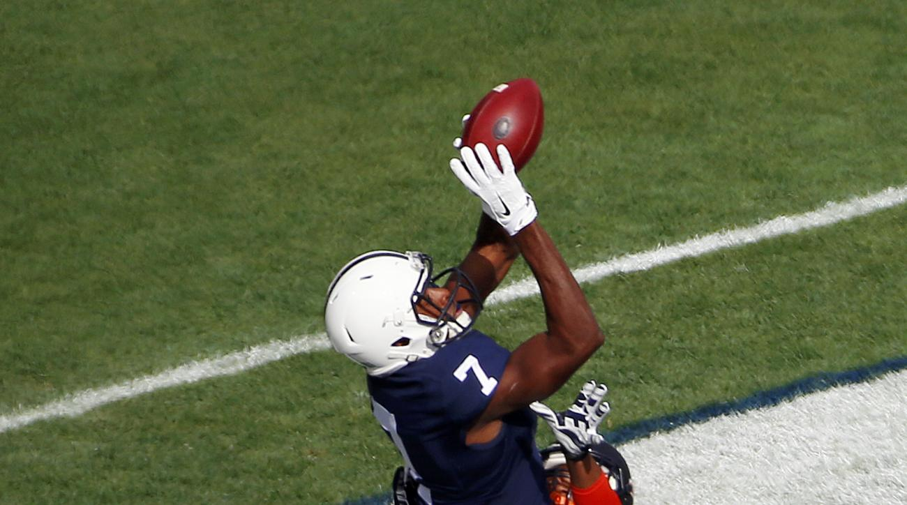 Penn State wide receiver Geno Lewis (7) catches a touchdown pass from quarterback Christian Hackenberg over Illinois defensive back Eaton Spence (27) during the first half of an NCAA college football game in State College, Pa., Saturday, Oct. 31, 2015. (A