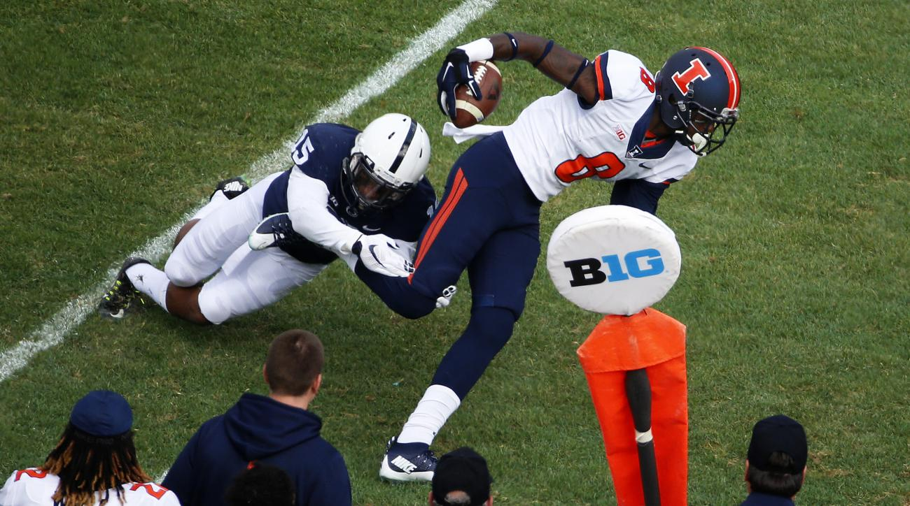 Illinois wide receiver Geronimo Allison (8) slips away from Penn State cornerback Grant Haley (15) after catching a pass from quarterback Wes Lunt during the first half of an NCAA college football game in State College, Pa., Saturday, Oct. 31, 2015. (AP P