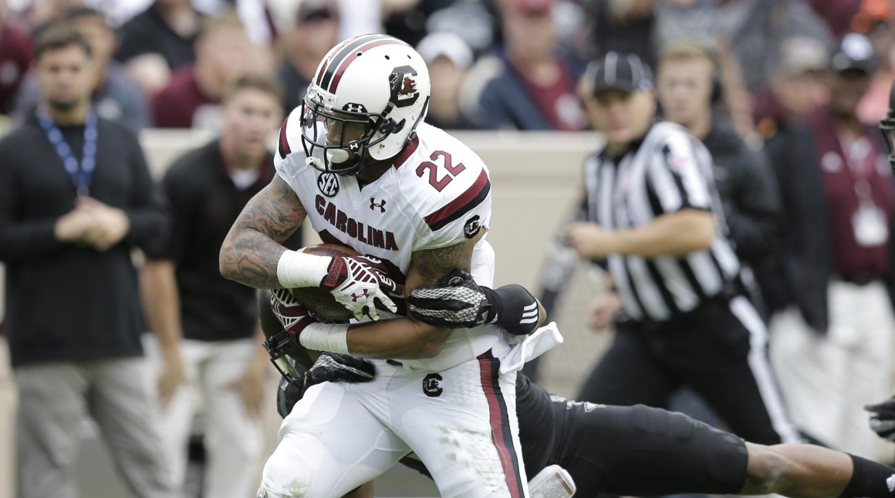 South Carolina running back Brandon Wilds (22) is hit as he runs against Texas A&M during the first half of an NCAA college football game, Saturday, Oct. 31, 2015, in College Station, Texas. (AP Photo/Eric Gay)