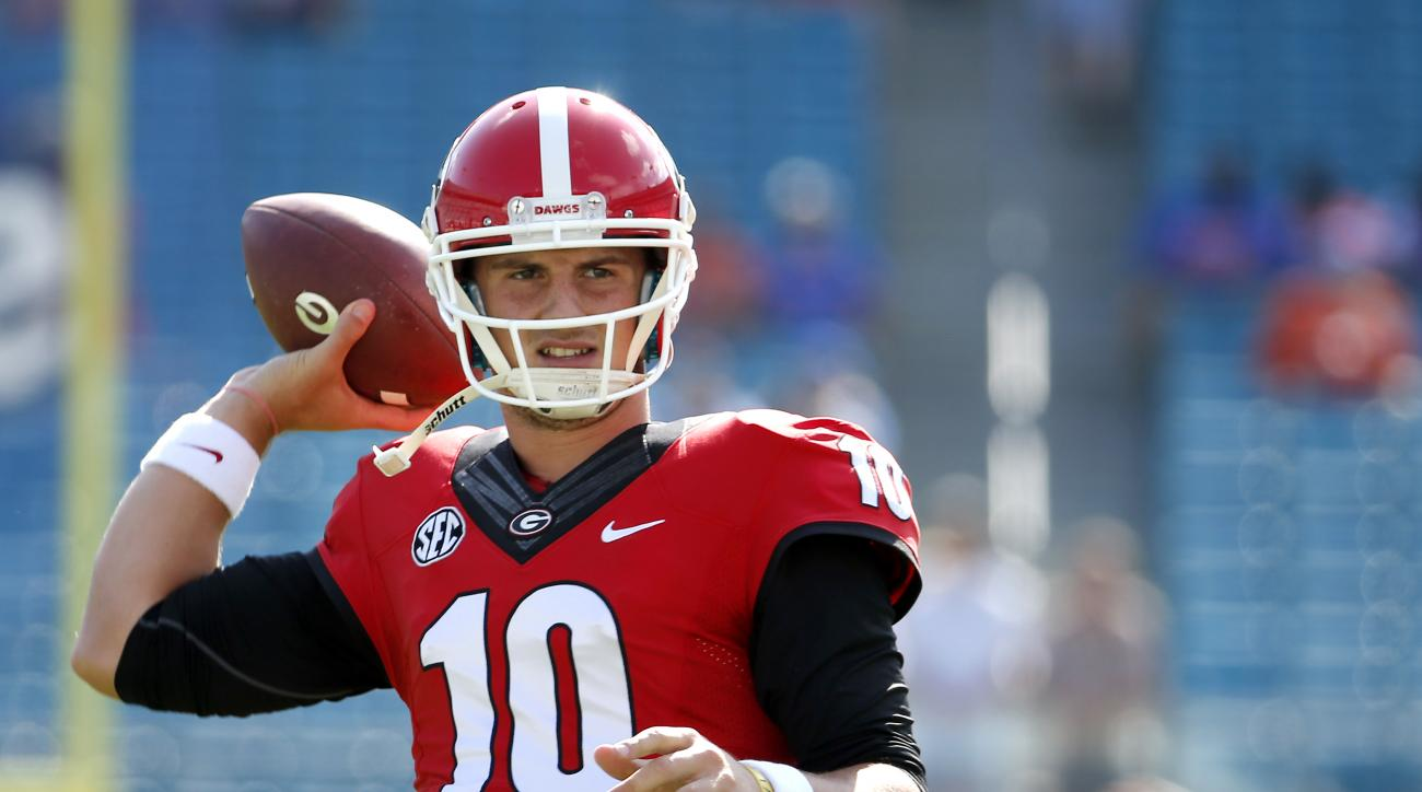 Georgia quarterback Faton Bauta (10) warms up before the start of an NCAA college football game against Florida  Saturday, Oct. 31, 2015, in Jacksonville, Fla. (AP Photo/Stephen B. Morton)