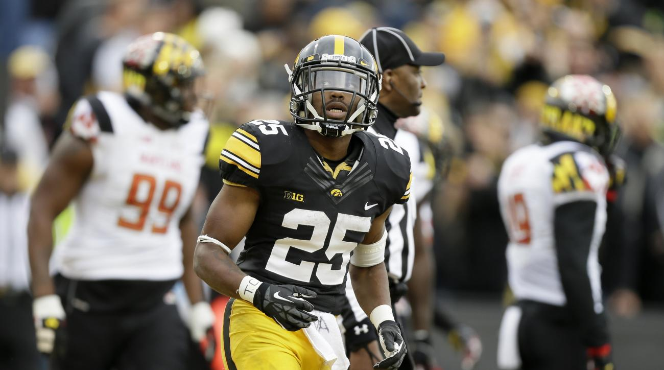 Iowa running back Akrum Wadley celebrates after scoring on an 11-yard touchdown run during the first half of an NCAA college football game against Maryland, Saturday, Oct. 31, 2015, in Iowa City, Iowa. (AP Photo/Charlie Neibergall)