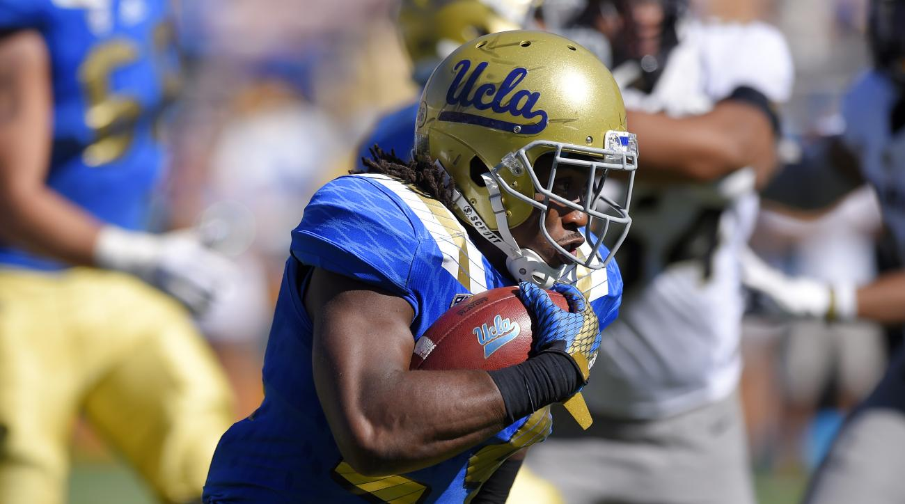 UCLA running back Paul Perkins runs the ball 82 yards for a touchdown during the first half of an NCAA college football game against Colorado, Saturday, Oct. 31, 2015, in Pasadena, Calif. (AP Photo/Mark J. Terrill)