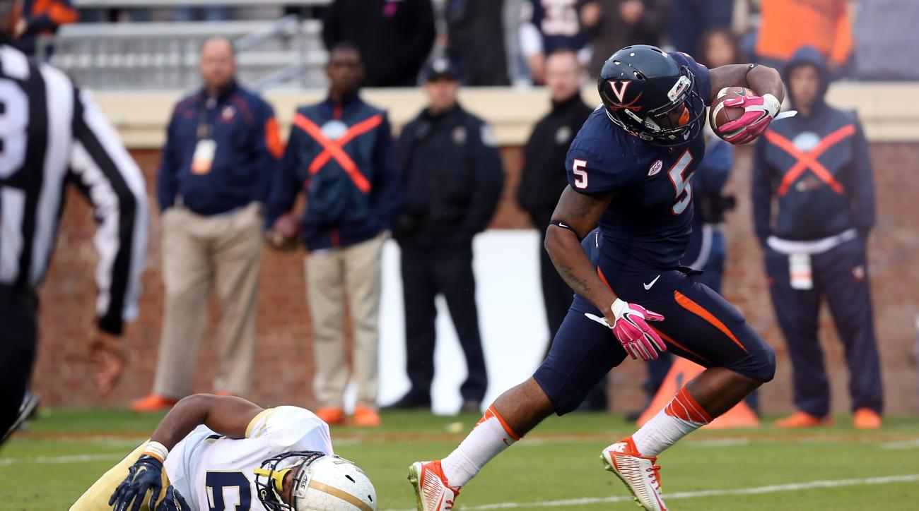Virginia quarterback David Watford (5) gets past Georgia Tech defensive back Chris Milton (6) for the touchdown during the second half of an ACC college football game at Scott Stadium, Saturday, Oct. 31, 2015, in Charlottesville, Va. (AP Photo/Andrew Shur