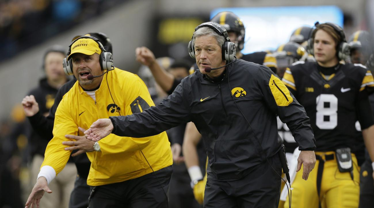 Iowa head coach Kirk Ferentz directs his team during the first half of an NCAA college football game against Maryland, Saturday, Oct. 31, 2015, in Iowa City, Iowa. Iowa won 31-15. (AP Photo/Charlie Neibergall)
