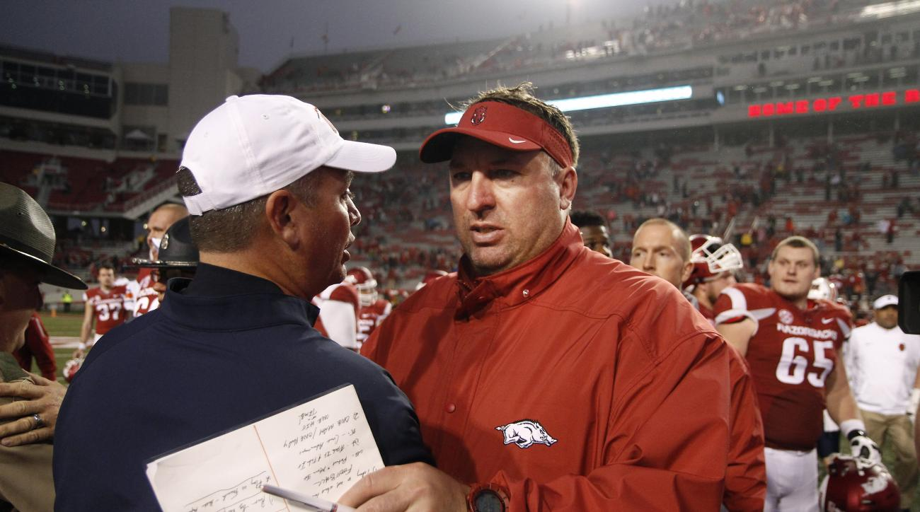 Arkansas' Bret Bielema, right, shakes hands with Tennessee-Martin's Jason Simpson at the conclusion of an NCAA college football game Saturday, Oct. 31, 2015, in Fayetteville, Ark. Arkansas won 63-28. (AP Photo/Samantha Baker)