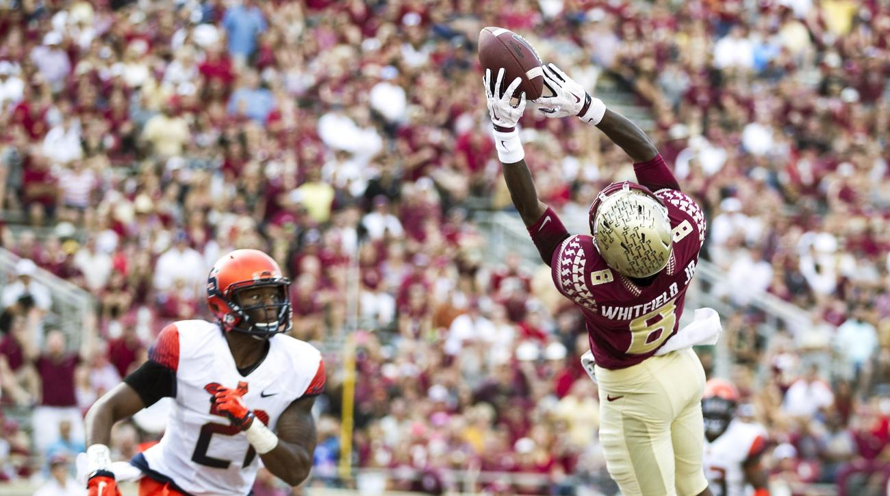 Florida State wide receiver Kermit Whitfield can't hang on to a pass in the endzone as Syracuse safety Chauncey Scissum looks on in the second half of an NCAA college football game in Tallahassee, Fla., Saturday, Oct. 31, 2015.  Florida State defeated Syr