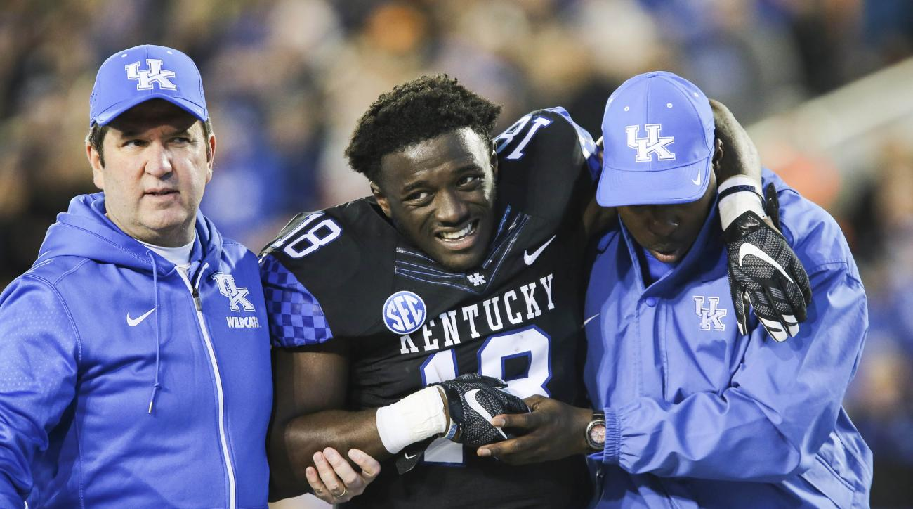 Kentucky running back Stanley Williams is helped off the field after an injury during the first half of an NCAA college football game against Tennessee, Saturday, Oct. 31, 2015, in Lexington, Ky. (AP Photo/David Stephenson)