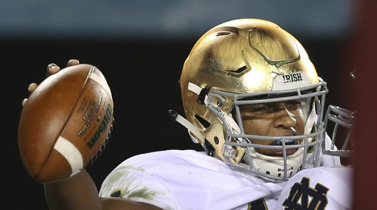 Notre Dame quarterback DeShone Kizer (14) celebrates his touchdown during the first half of an NCAA college football game against Temple Saturday, Oct. 31, 2015, in Philadelphia. (AP Photo/Mel Evans)