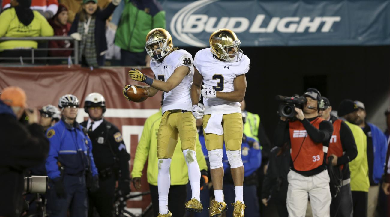 Philadelphia native, Notre Dame wide receiver Will Fuller,left, celebrates his winning touchdown with Amir Carlisle, right, near the end of the second half of an NCAA college football game against Temple Saturday, Oct. 31, 2015, in Philadelphia. Notre Dam