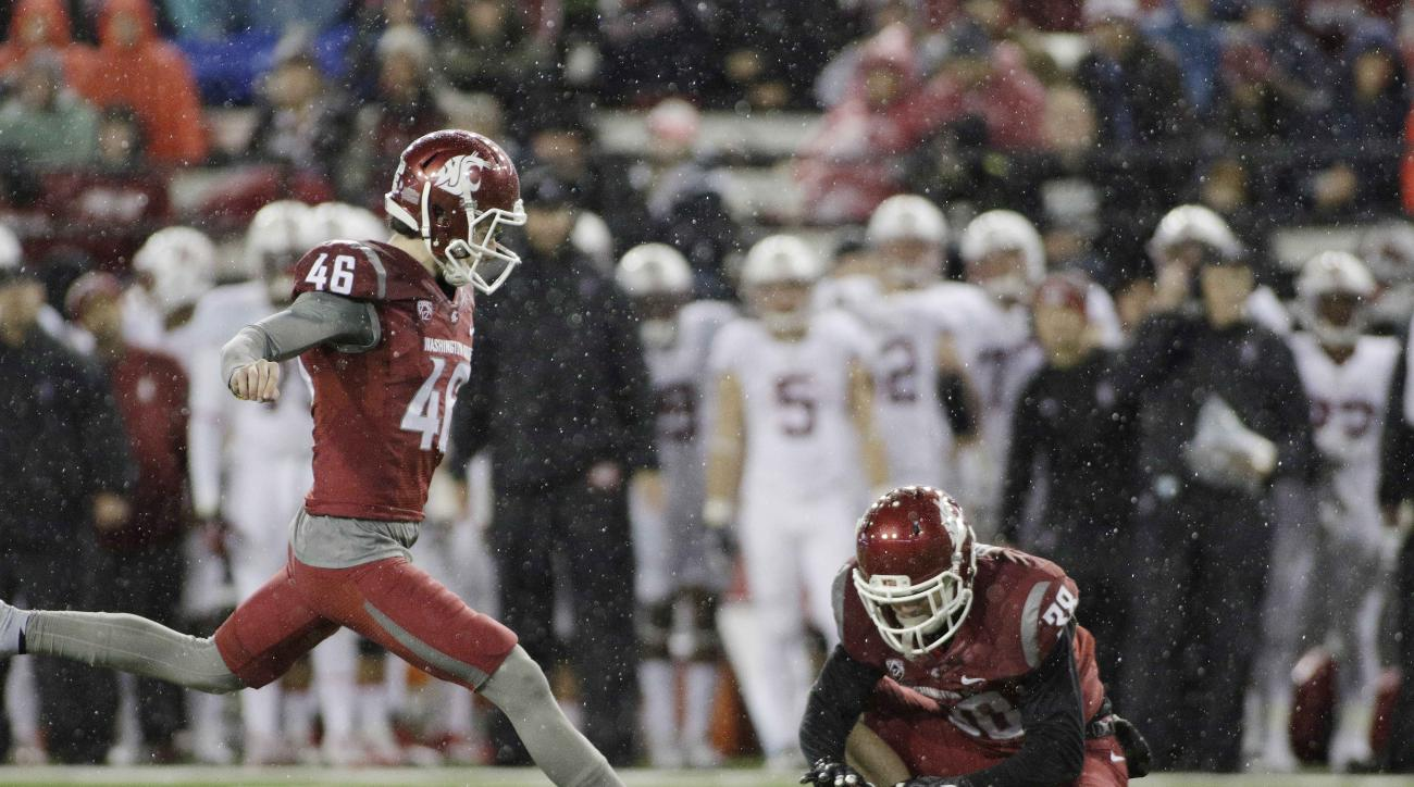 Washington State place kicker Erik Powell (46) kicks a field goal as wide receiver Kaleb Fossum (38) holds during the first half of an NCAA college football game against Stanford, Saturday, Oct. 31, 2015, in Pullman, Wash. (AP Photo/Young Kwak)