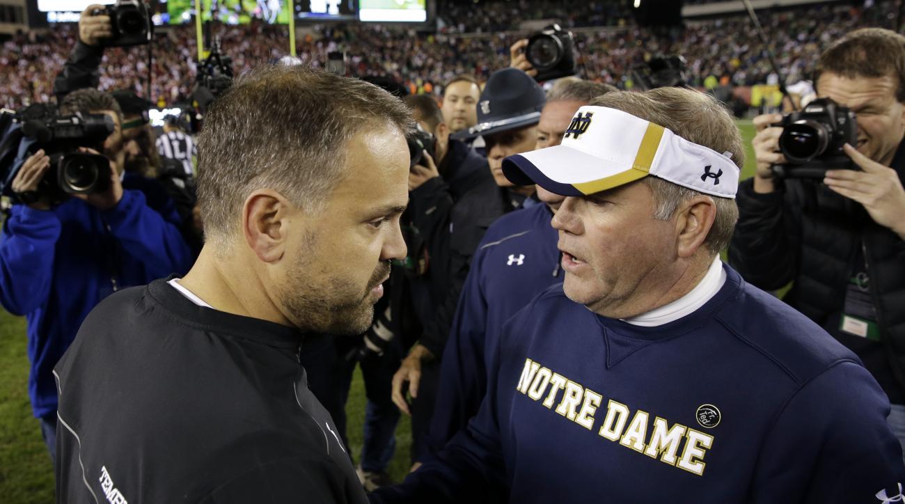 Temple head coach Matt Rhule, left, greets Notre Dame head coach Brian Kelly after an NCAA college football game Saturday, Oct. 31, 2015, in Philadelphia. Notre Dame won 24-20. (AP Photo/Mel Evans)