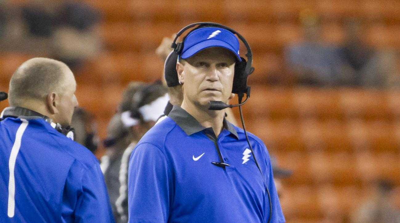 Air Force coach Troy Calhoun watches a replay on the scoreboard during the third quarter of his team's NCAA college football game against Hawaii on Saturday, Oct. 31, 2015, in Honolulu. (AP Photo/Eugene Tanner)