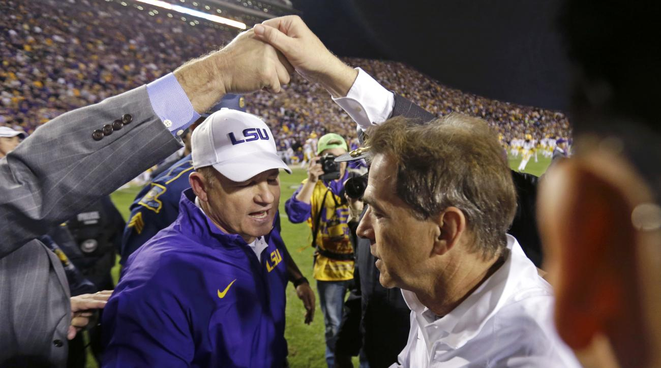 FILE - In this Nov. 8, 2014, file photo, LSU coach Les Miles, left, shakes hands with Alabama coach Nick Saban after an NCAA college football game in Baton Rouge, La. No. 4 LSU and No. 7 Alabama will play Saturday, Nov. 7, 2015, in Tuscaloosa, Ala.  (AP P
