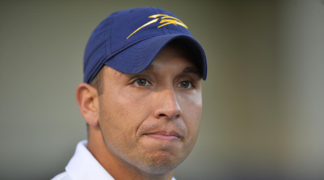 FILE - In this Oct. 10, 2015, file photo, Toledo head coach Matt Campbell reacts after a 38-7 win over Kent State in an NCAA college football game in Toledo, Ohio. The 35-year-old Ohioan isn't climbing the career ladder as much as he is bounding up the st