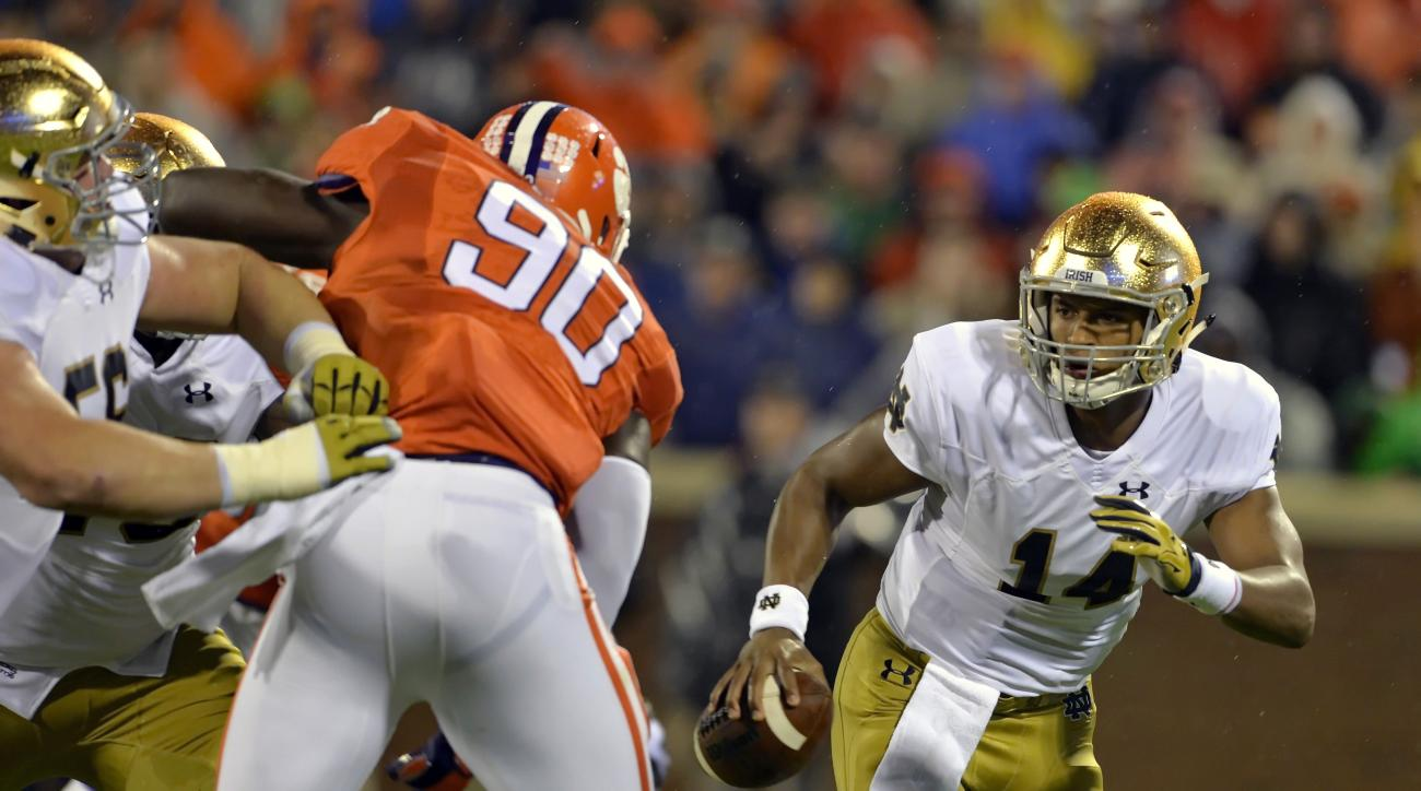 FILE- In this Oct. 3, 2015, file photo, Notre Dame quarterback DeShone Kizer, right, scrambles out of the pocket while pressured by Clemson's Shaq Lawson during the first half of an NCAA college football game in Clemson, S.C. The College Football Playoff