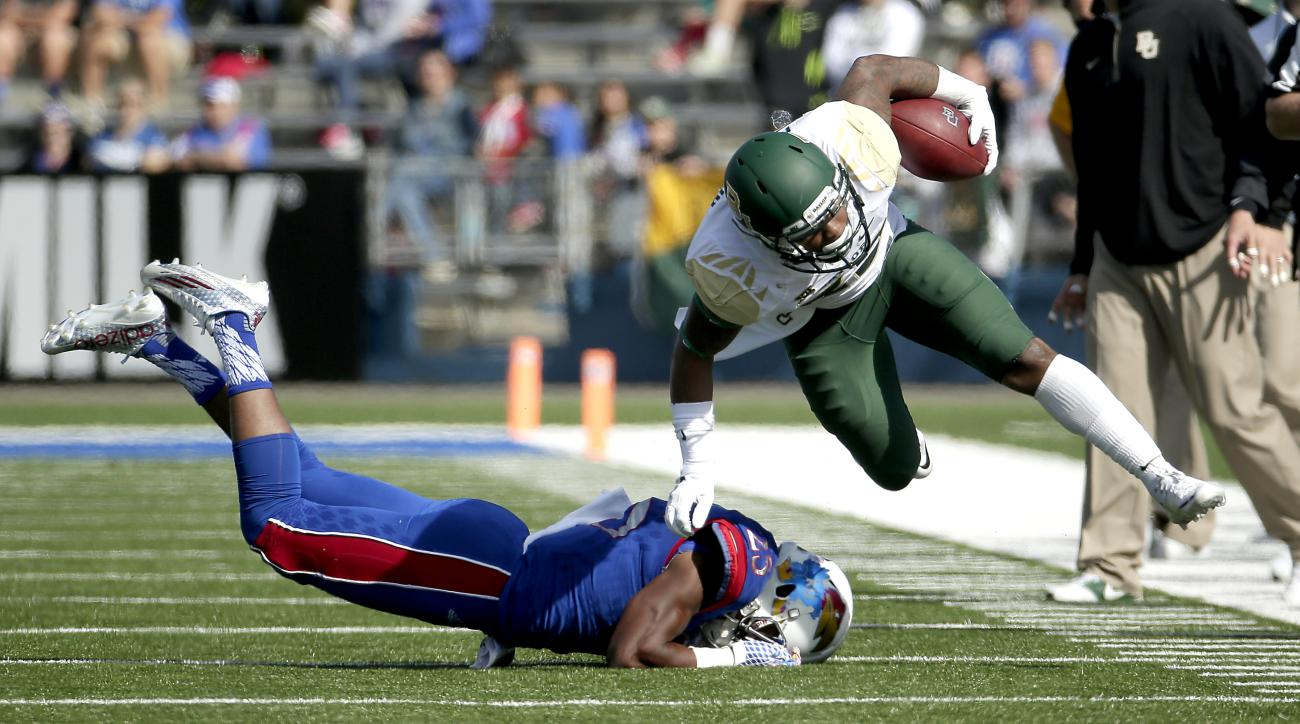 FILE- In this Oct. 10, 2015, photo, Baylor running back Shock Linwood (32) gets past Kansas cornerback Marnez Ogletree (25) as the runs the ball during the first half of an NCAA college football game in Lawrence, Kan. The College Football Playoff committe